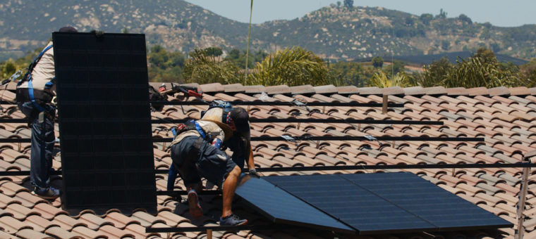 Solar Installers Securing Panels Los Angeles